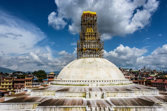 Boudhanath Stupa shown with scaffolding erected to facilitate repairs in this 24 July 2015 photograph. | Image copyright: Dutourdumonde Photography