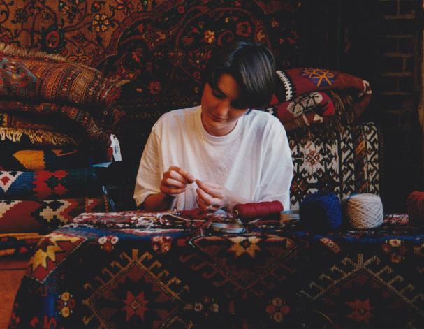 A young(er) Christiane Millinger repairing a rug. | Image courtesy of Christiane Millinger