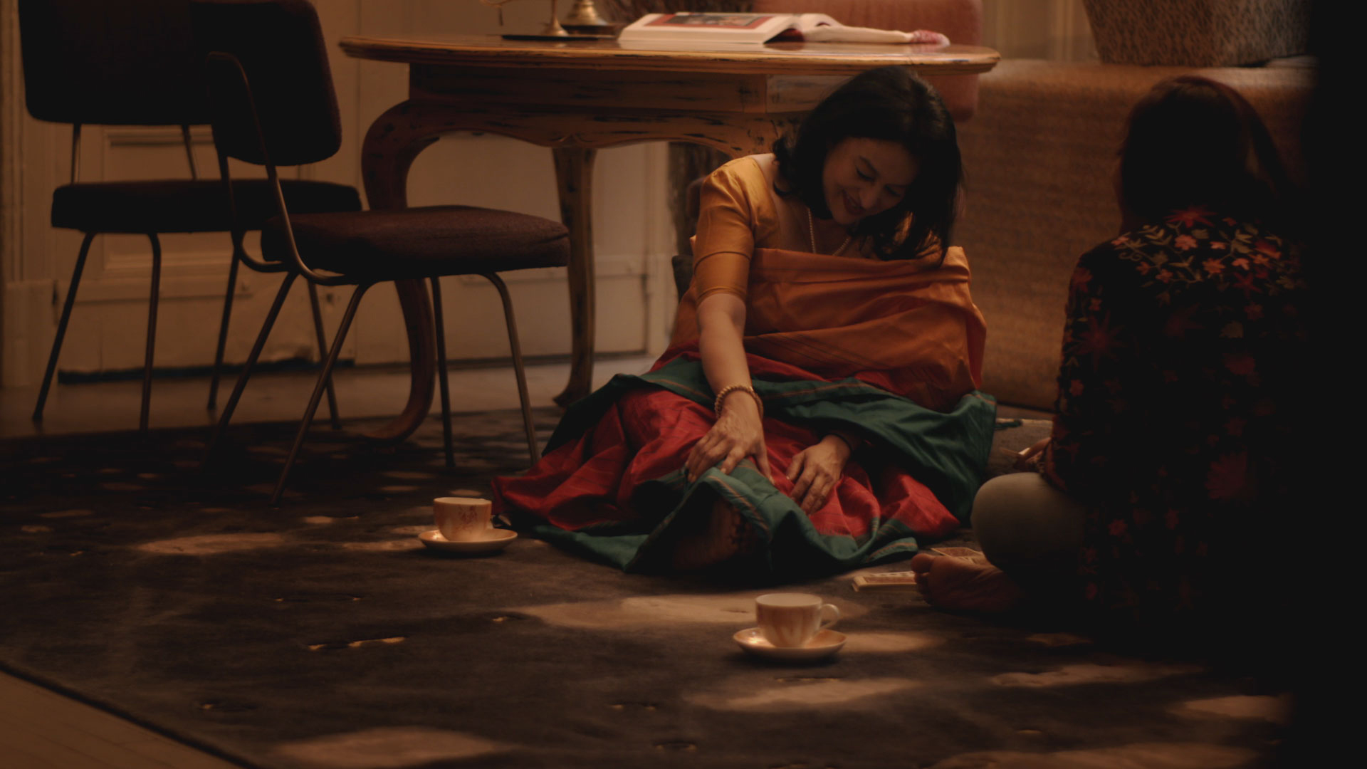 Still image of women playing cards in a short film by Karishma Dev Dube presented by Fort Street Studio. | Image courtesy of Fort Street Studio.