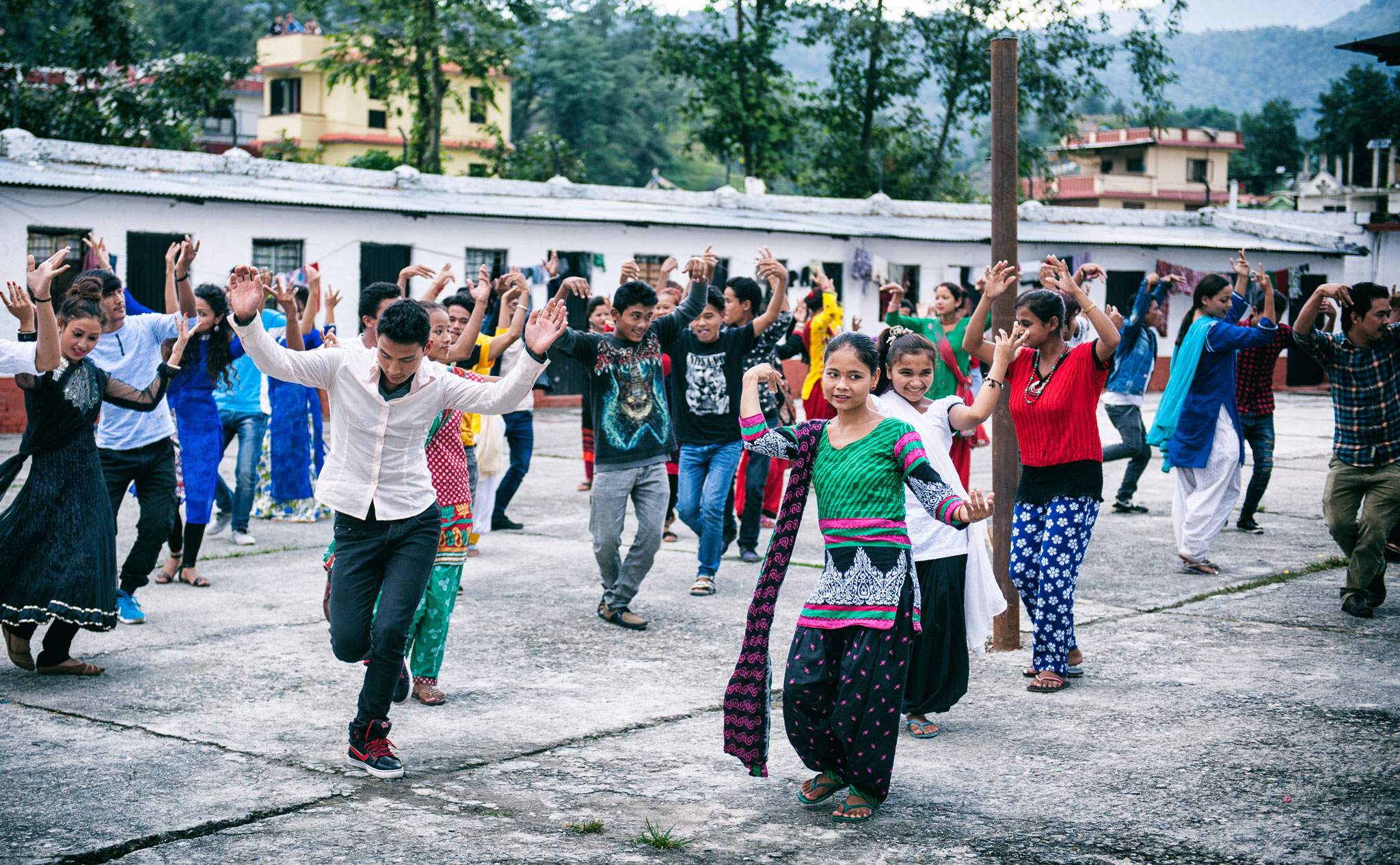 Weavers were cast as dancers to celebrate life 'shining brightly at home' in 'Nine Million Stars'. A joint project between Jan Kath and Label STEP, the video celebrates Nepali carpet weaving as a sustainable alternative to migrant labour. | Image courtesy of Jan Kath.