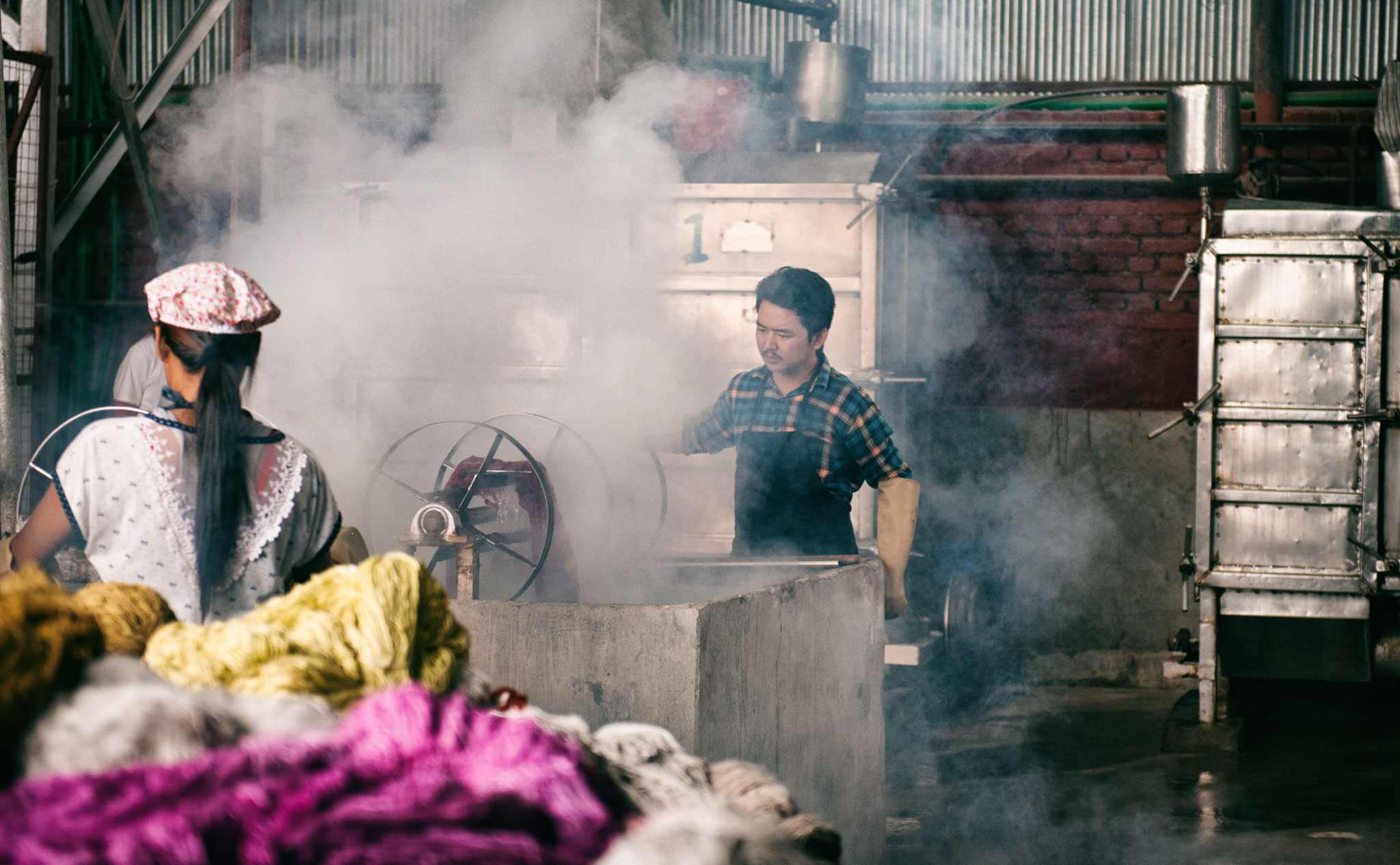 Noted Nepali stage actor Tika Bhakta Jirel is shown during filming of a dye shop scene in 'Nine Million Stars'. | Image courtesy of Jan Kath.
