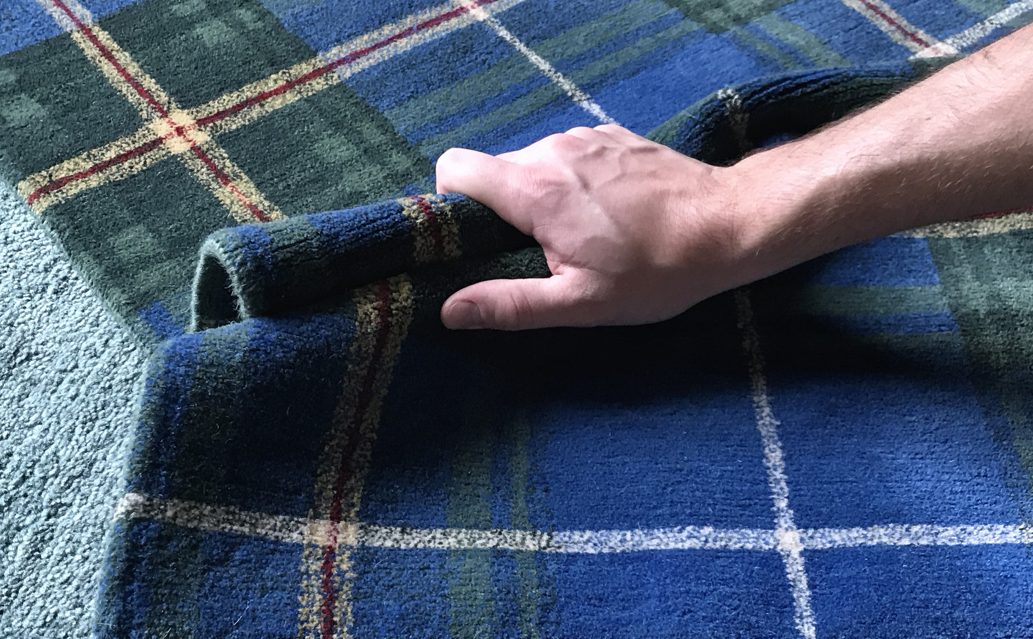The fastidious notion of 'handle' as the pliability and weight felt while grasping the body of the carpet.   Image by The Ruggist.