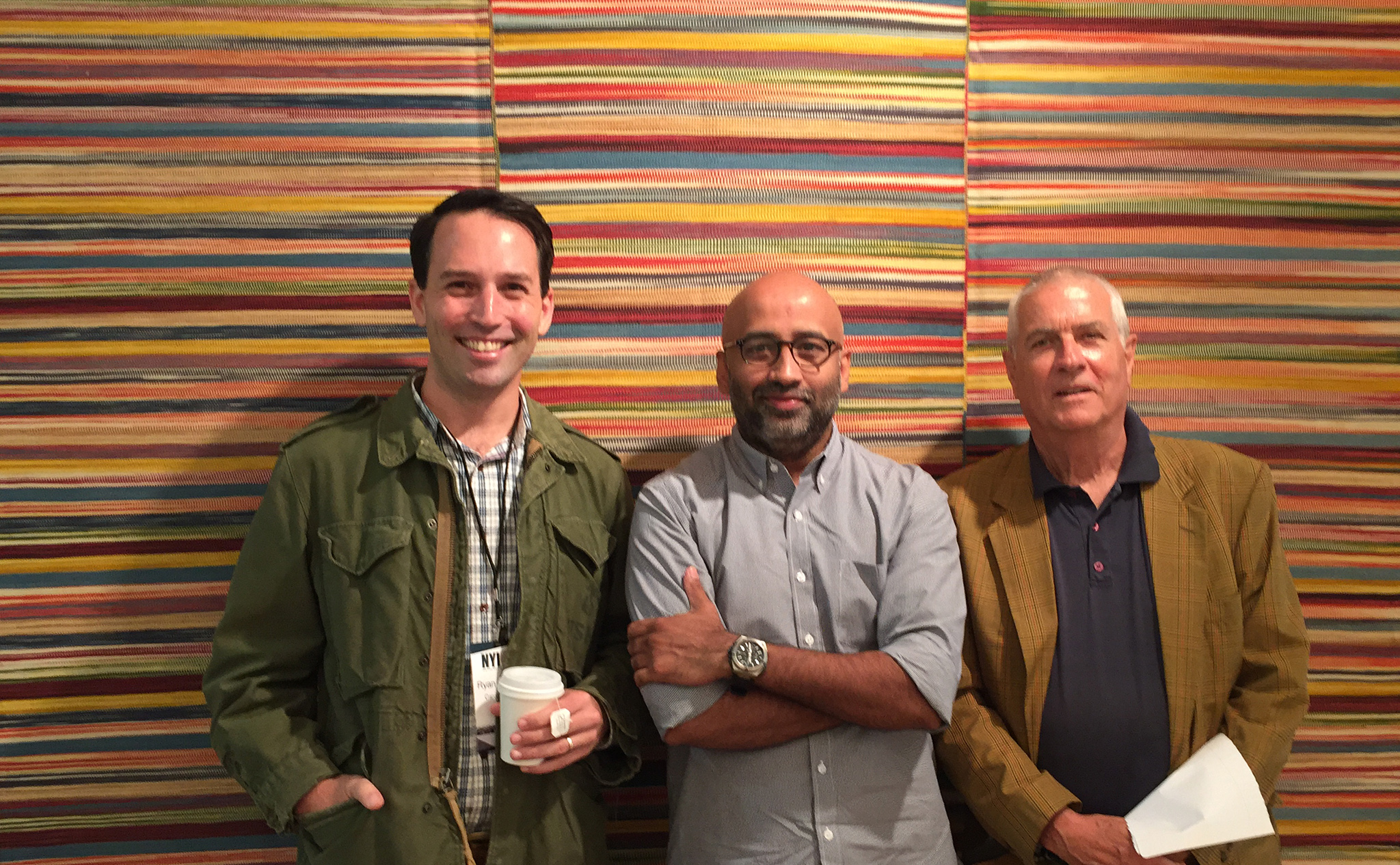 Ryan Reitmeyer, Michael Mandapati, and Werner Weber (left to right) stand in front of a Iranian flatweave from Werner Weber. | Image by The Ruggist.