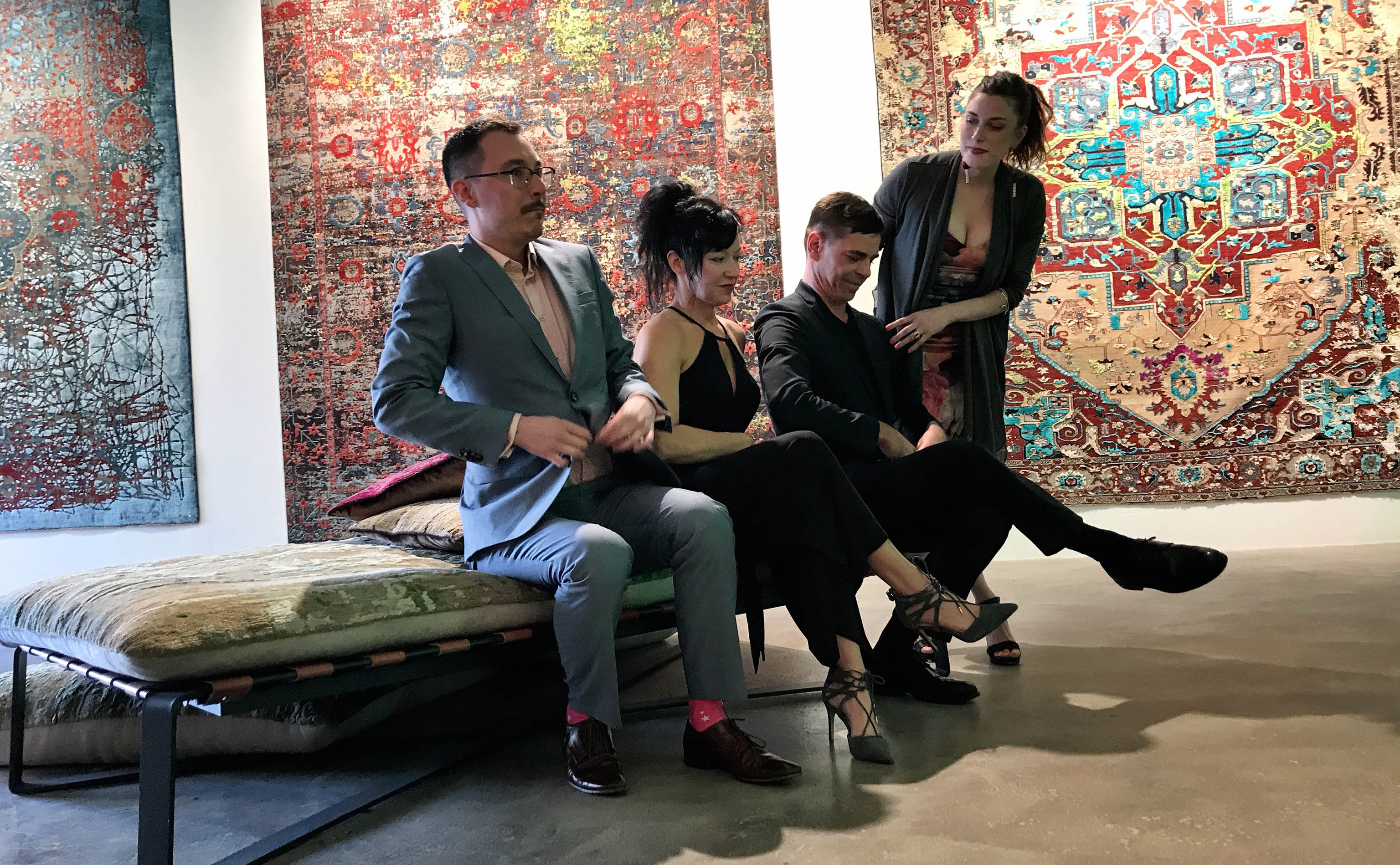 Yvan Semenowycz, Jenni Finlay, Jan Kath, and Robyn Waffle (left ot right) shown primping before the official photographer, Nancy Kim, snapped the group photo just as the opening party for Finlay and Kath's new Jan Kath Toronto showroom got underway on Thursday, 10 May 2018. | Image by The Ruggist.
