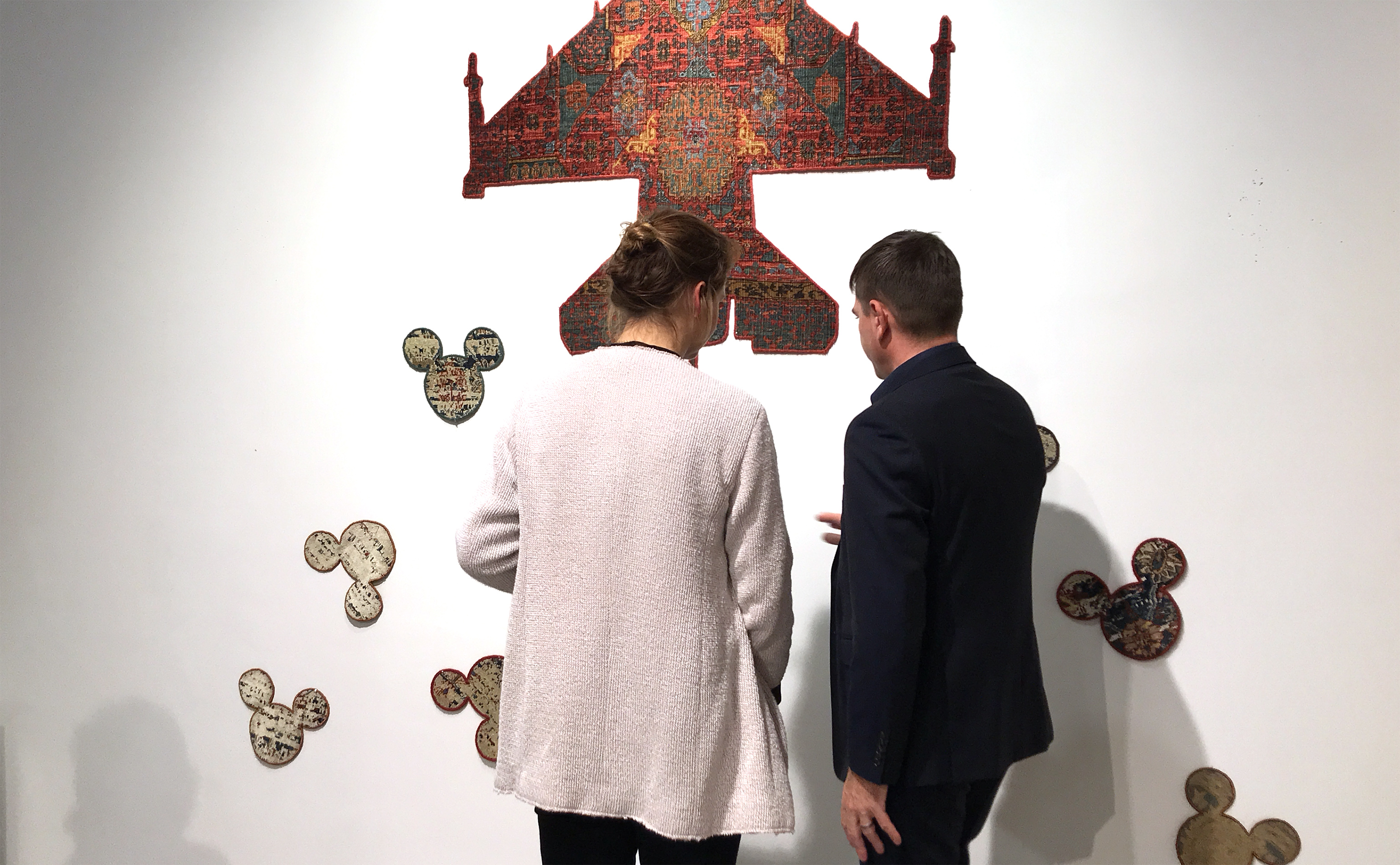 Miriam Moll (left) of Nyhues - Contemporary Art Rugs shown in discussion with Jan Kath himself at Jan Kath Köln during the 'Make Rugs Not War' vernissage at Jan Kath Köln on 15 January 2019. | Photograph by The Ruggist.