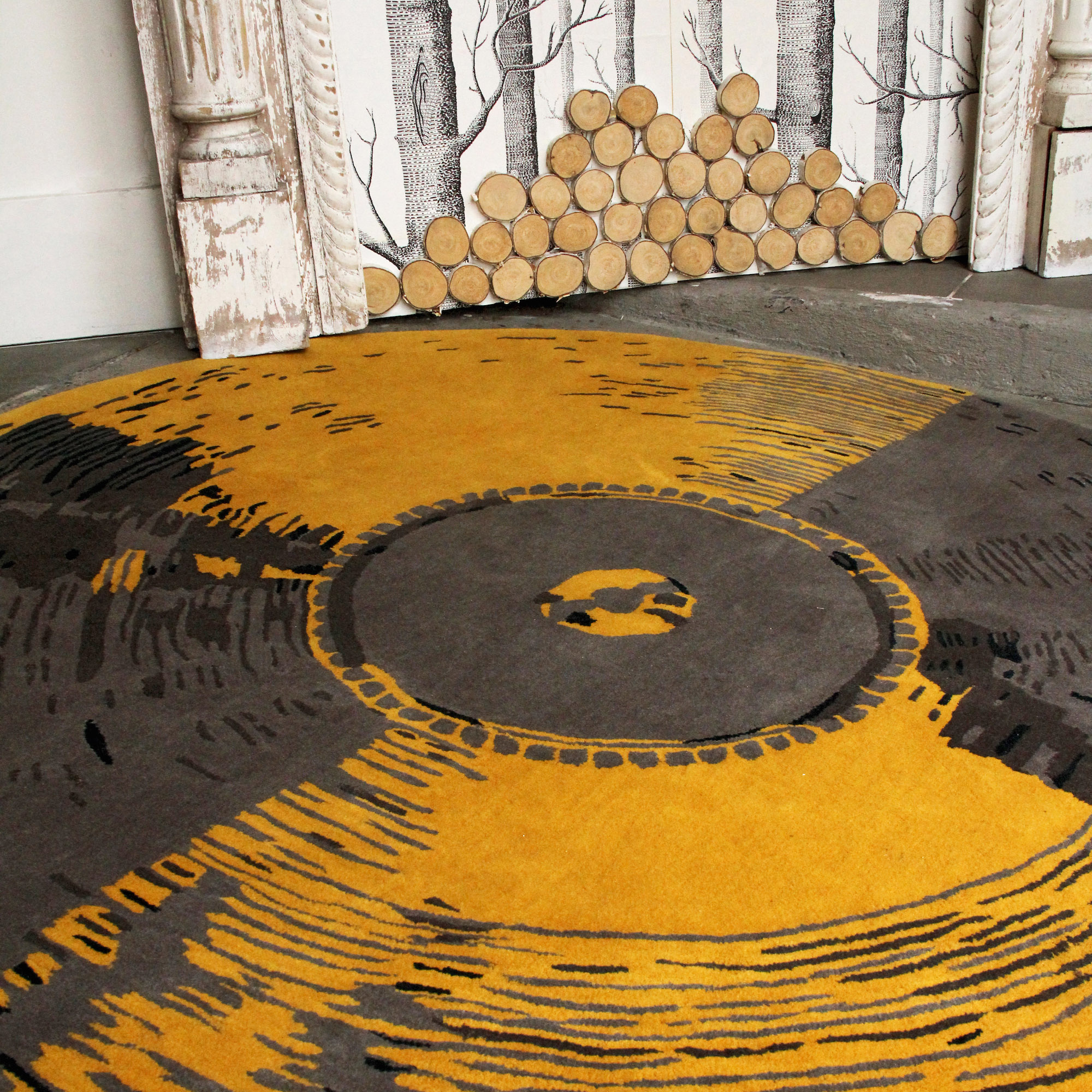 'Vinyl' by Kush Rugs shown in situ theatricalis in colourway 'Canary' | Photograph courtesy of Kush Rugs.